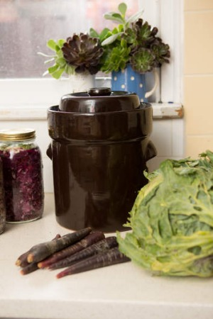 Sauerkraut crocks, pictured, are better suited to fermenting foods than preserving jars but are far more expensive.
