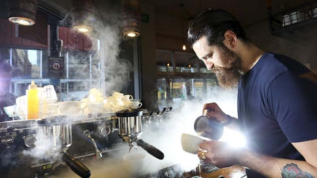 Steaming success: Barista Sean McManus makes a coffee at Single Origin Roasters in Surry Hills. The cost of coffee is ...
