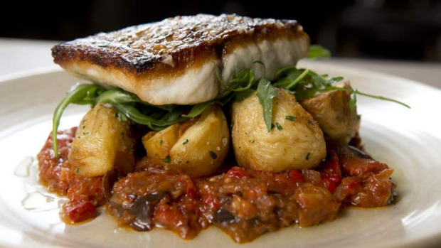 Perfectyle cooked ... The barramundi with spiced eggplant and crispy potatoes.