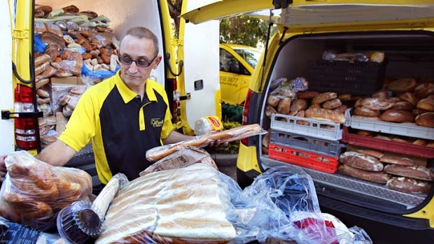 Unwanted bread: OzHarvest driver Nigel Broadbridge sorting just one day's collection of surplus bread.