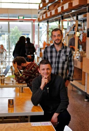 Chasing the bean: Co-owners Andy Gelman and Dean Atkins (seated) of cafe Omar and the Marvellous Coffee Bird in Gardenvale.