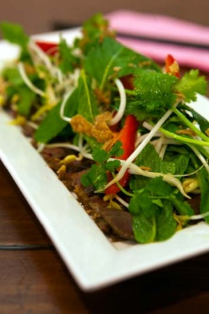 Feel-good food: Barbecue sweet soy beef with hot and sour herb.