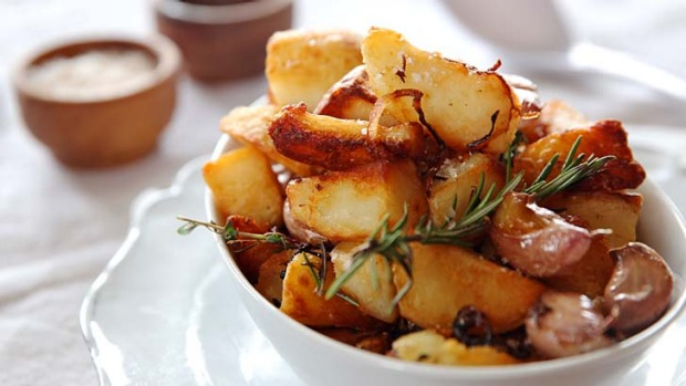 Golden and crunchy: Duck-fat potatoes with garlic and rosemary.