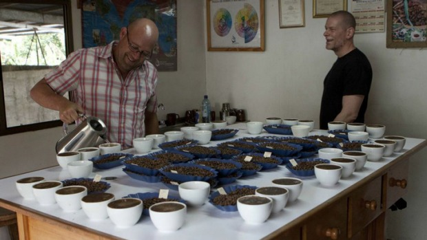Toby Smith, left, tests out the first crop of coffee beans from his new farm in Santa Clara, Panama, earlier this year.