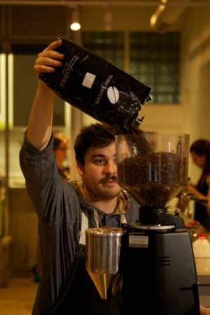 Barista Paul Schliewe prepares coffee beans from the Finca Santa Teresa coffee farm in Panama for the Toby's Estate cafe ...