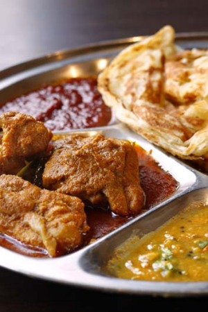 Go-to dish: Roti canai with chicken curry, $11.90.
