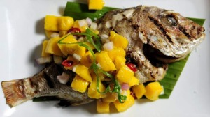 Baked whole baby snapper with mango salsa at Kusina Filippino restaurant in Weston.