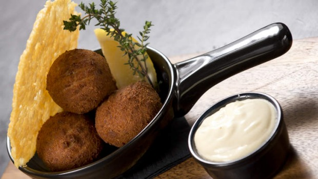 Arancini balls with a parmesan crisp and aioli on the side.