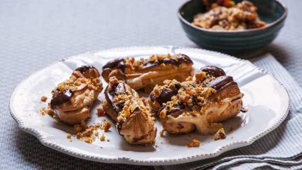A simple choux pastry has been shaped into eclairs and dressed up with espresso cream and praline.