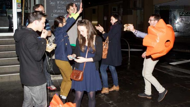 Melburnians celebrate the delivery of their jafflechutes in Flinders Lane.