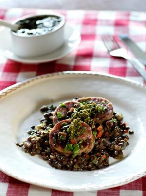 Cotechino with lentils...Men will put up with lentils in order to eat large, fatty pork sausage.