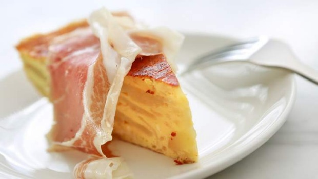 Tortilla crowned by thin-shaved culatello.
