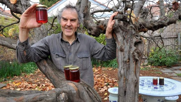 Sweet ... Barton resident, Rupert Summerson with his backyard quince tree and jars of quince jam.