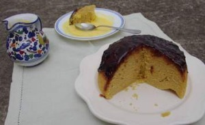 Old-fashioned sponge cake with plum jam and custard.