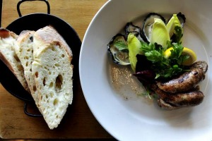 Toulouse sausage and oysters at Silo Bakery.