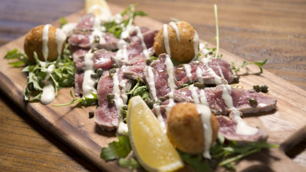 Vitello Tonnato: Poached veal with potato and tuna fritters.