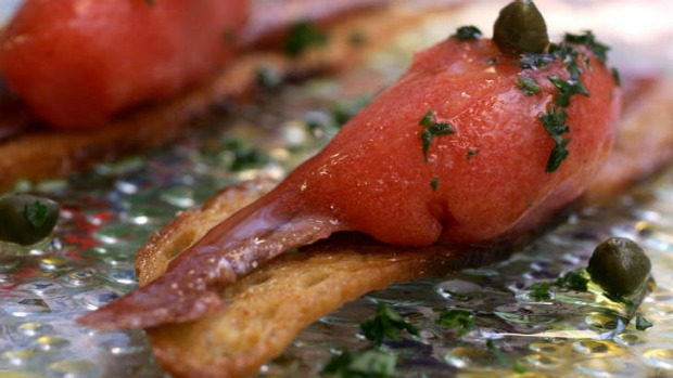 Go-to dish at Movida: anchovy, layered on a square of toast with smoked tomato sorbet.