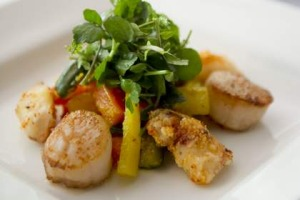 Spicy daikon and carrot give the marinated scallops and calamari with vegetable achar and watercress dish a real kick.
