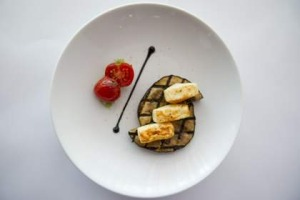 Tofu and eggplant with roasted tomatoes and black sesame, at the Lanterne Rooms.