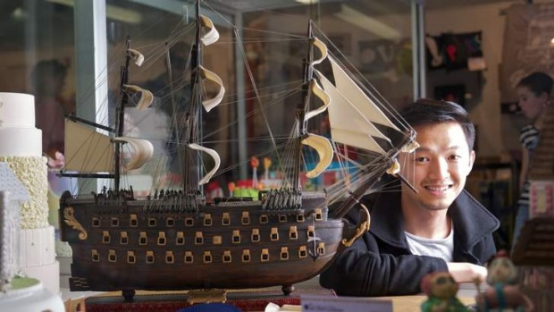 Cuc Thanh Lam (also known as Ken) with his award winning ship cake at the Royal Melbourne show.