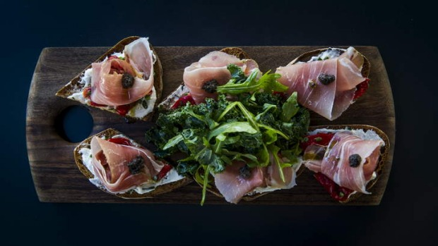 Well balanced: The Prosciutto tartine with basil ricotta, roasted red capsicum, tapenade, prosciutto and rocket.