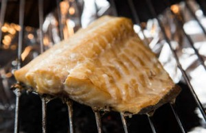 All you need to hot smoke fish is a heat source and a way to keep the smoke in.