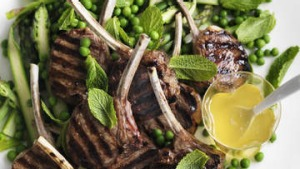 Barbecued lamb cutlets with mint sauce.