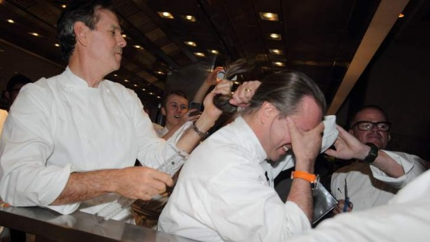 US chef Thomas Keller lops Neil Perry's ponytail for $50,000 for the Starlight Foundation.