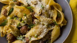 Conchiglie pasta with pork polpette and artichokes