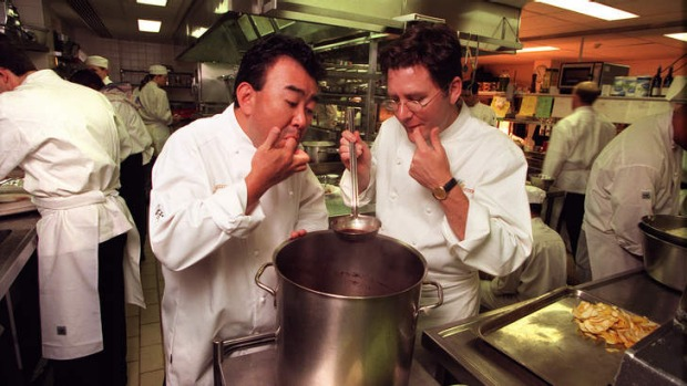 Charlie Trotter and Tetsuya Wakuda cook together in 1999.
