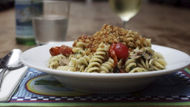 Fusilli with confit tuna, salsa verde, cherry tomatoes and pangrattato.