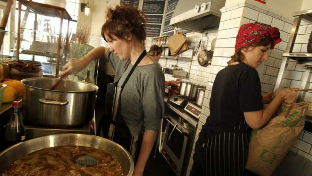 Food economy: Alex Elliott-Howery and Jaimee Edwards pickle pears at Cornersmith Cafe.
