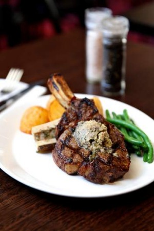 Juicy delight: Rib-eye on the bone from the Bar & Grill at The Oaks Hotel in Neutral Bay.