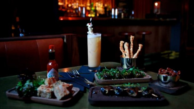 Enjoy the show and the food at Golden Age Cinema & Bar.