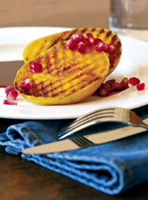 Barbecued mango cheeks with pomegranate.