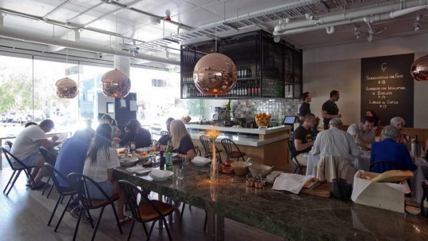 Slick and shiny: Join the communal table at a Tavola, Bondi.