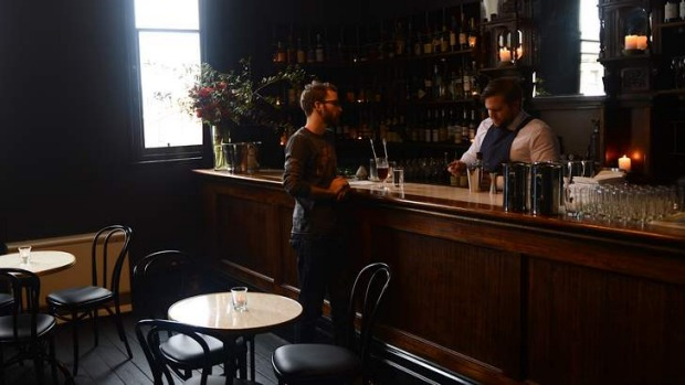 Higher ground: James Tait holds court behind the bar at Thomas Olive.