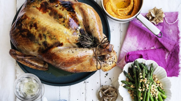 Christmas with all the trimmings: Roast turkey with stuffing and sweet potato puree (top right) and asparagus with almonds.