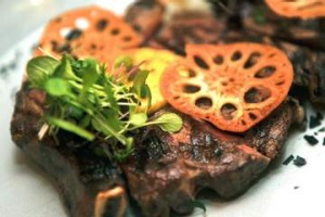 Porterhouse steak with coconut butter and lotus root.