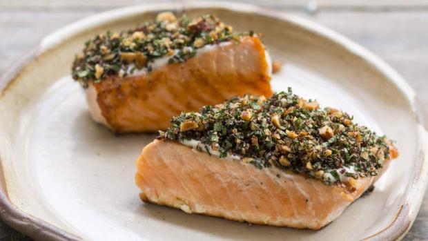 Vibrant barbecued salmon with tahini and herbs.