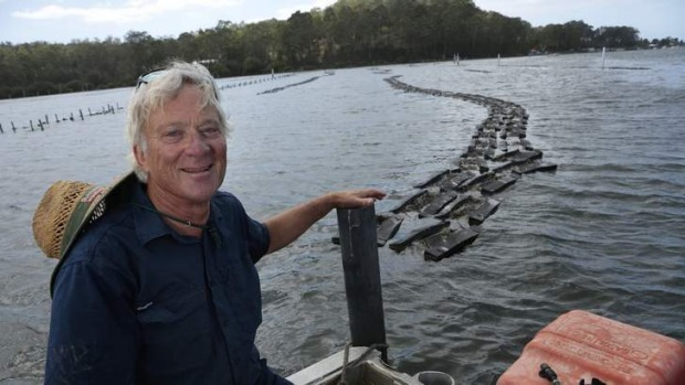 Job with a view: Kevin McAsh at the 20-hectare oyster farm near Batemans Bay.