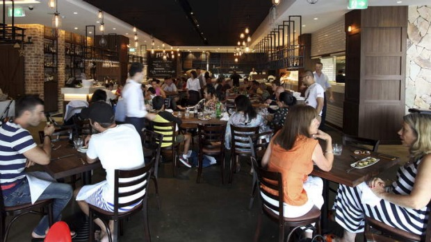 Mercato e Cucina's interior is all polished concrete, dark wood, exposed brick and white tiles.
