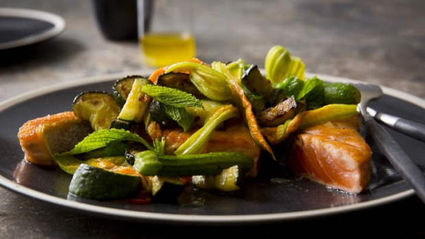 Pan-fried salmon with fried zucchini, zucchini flowers, chilli and mint.