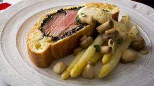Boeuf en croute with horseradish cream and pickled mushrooms.