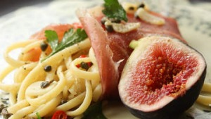 Prosciutto-wrapped linguine with chilli, lemon and figs.