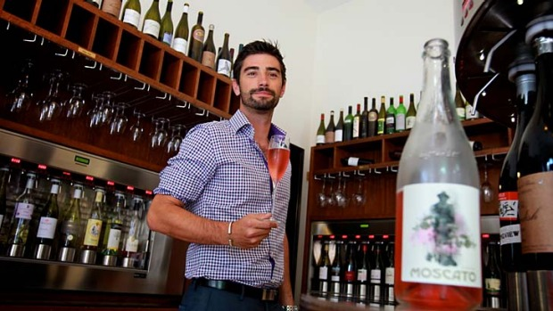 Sweet drop: Remi Pinatel, manager of Wine Odyssey in The Rocks, with a bottle from the wine bar's range of moscatos.