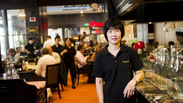 Loud and bustling: PappaRich Malaysian Delights. Pictured is owner Angie Ng.