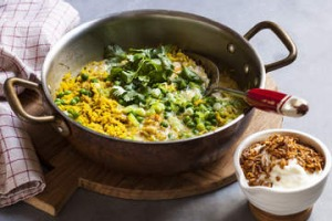 Quick curried rice with egg, spring onions & peas.