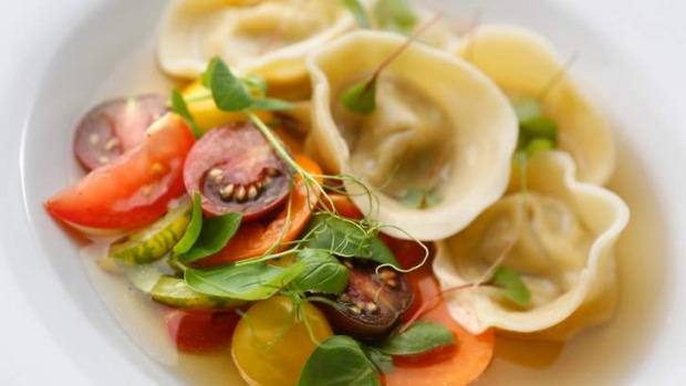 Tortellini with celeriac, basil and confit tomatoes.