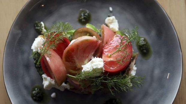 Excellent ingredients, simply assembled ... A plate of pesto, tomato and ricotta on toast.